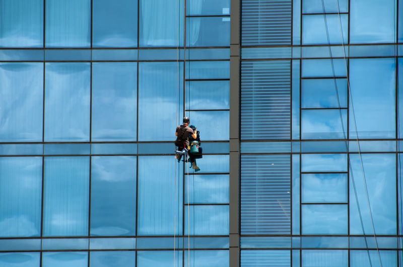 People working in modern glass building