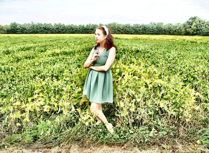 Gen in the Field II Beauty In Nature Casual Clothing Day Field Front View Full Length Grass Grassy Green Color Growth Landscape Leisure Activity Lifestyles Nature Outdoors Person Plant Portrait Rural Scene Sky Smiling Tranquil Scene Tranquility Young Adult
