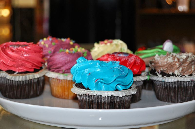 Close-Up Of Colorful Cupcakes In Plate On Table
