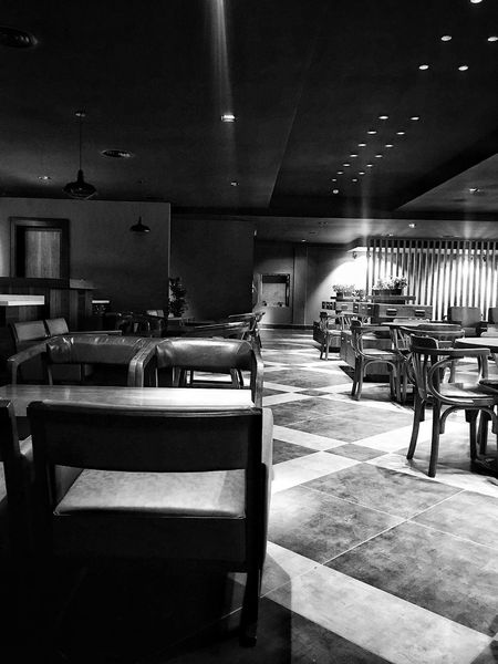 Where's the crowded when you feel alone !!! Furniture Design Furnitures Blackandwhite Photography Blackandwhite Bnw Architecture Interior Style Interor Views Interior Night Indoors  Table Restaurant Empty Chair No People Illuminated Day Home Showcase Interior
