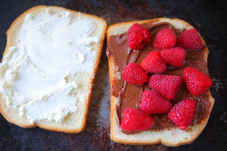 Sandwich with raspberries and chocolate Healthy Eating Food Freshness Indulgence Indoors  Close-up Ready-to-eat Sweet Food Temptation Breakfast Snack No People Raspberries Fresh Fruit Overhead White Bread Sandwich Snack Light Meal Tasty Delicious Natural Light Dark Background Red