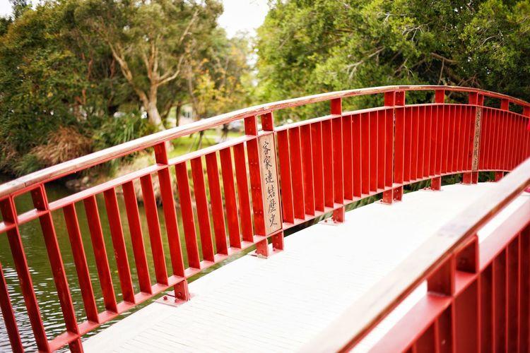 Red railing on bridge