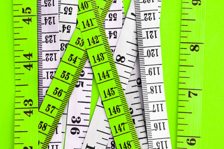 Close-up of tape measure on table