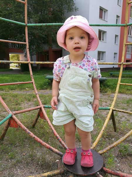 Baby Full Length Babies Only Babyhood Childhood One Person Day Casual Clothing Grass Outdoors Sun Hat People Standing Adult