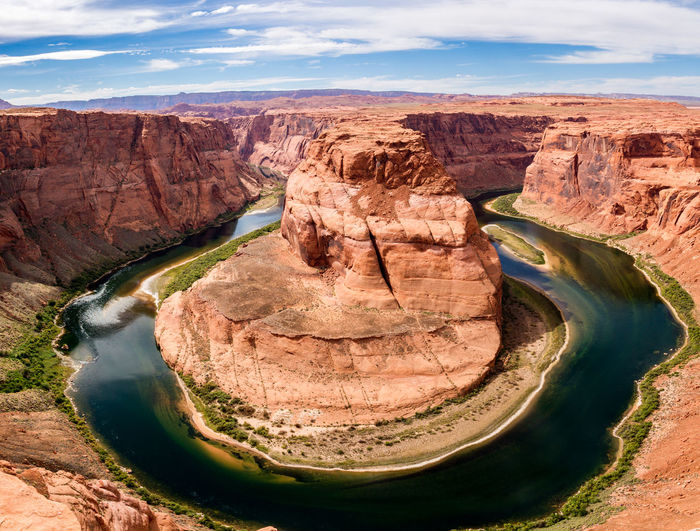 High Angle View Of Horseshoe Bend Against Cloudy Sky