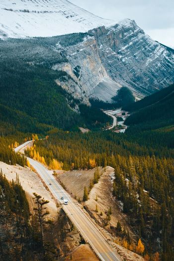 Road trip. Alberta Banff  Canada Plant Tree Mountain Transportation Road Nature No People Built Structure Cold Temperature Mode Of Transportation Growth Architecture Landscape High Angle View Snow City Outdoors Beauty In Nature Day Scenics - Nature