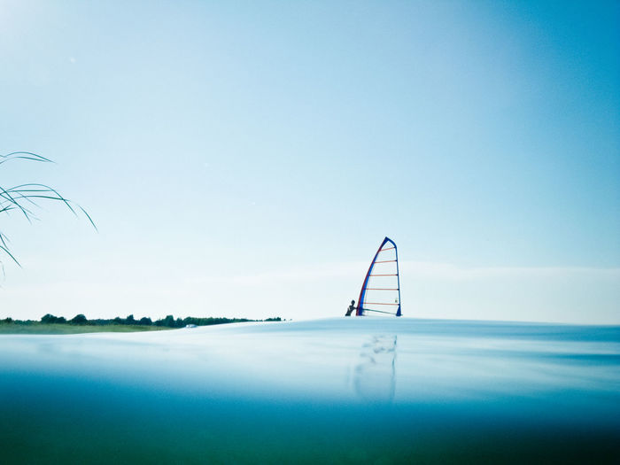 Flooded Nature Water Reflections Blue Copy Space Day Dramatic Idyllic Lake Nature Outdoors Reed Reflection Sea Sky Sport Summer Tranquil Scene Water Water Surface Watersports Wind Windsurf Windsurfing
