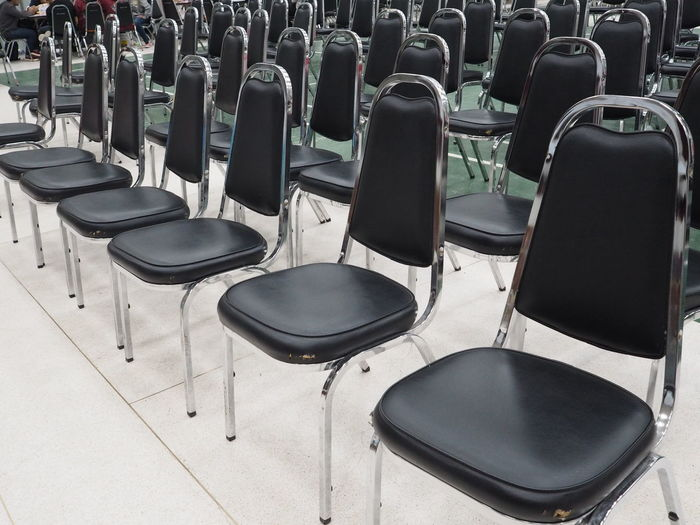 Chairs arrangement for meeting Absence Architecture Arrangement Arts Culture And Entertainment Auditorium Chair Day Empty Flooring In A Row Indoors  Large Group Of Objects Musical Equipment No People Order Repetition Seat Side By Side Still Life