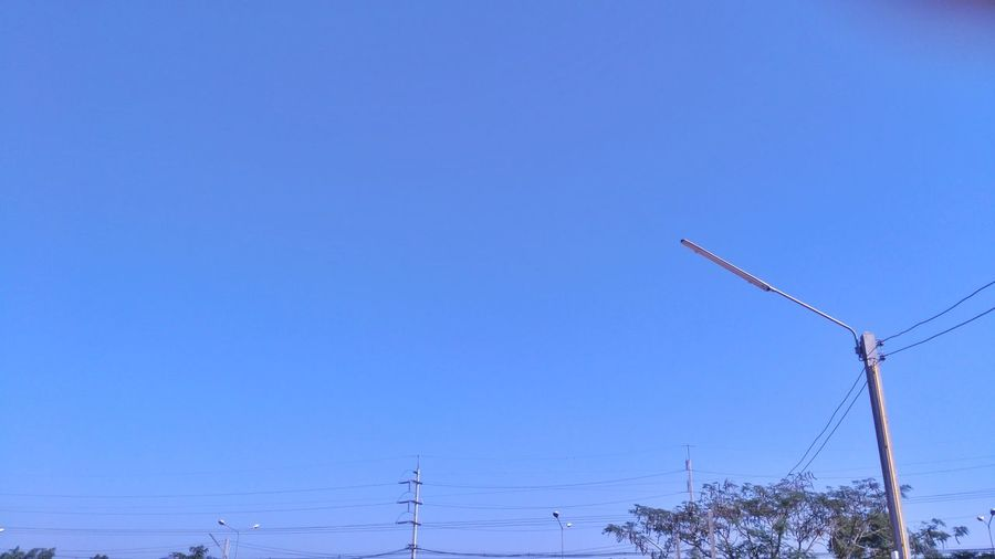 Fuel And Power Generation Cable Copy Space Electricity  Nature Power Supply No People Electricity Pylon Sky Blue Alternative Energy Technology Cold Temperature Outdoors Low Angle View Day Clear Sky Wind Power Rural Scene Wind Turbine