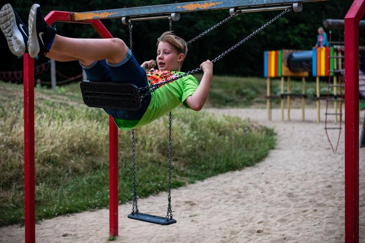 Boy on swing at playground