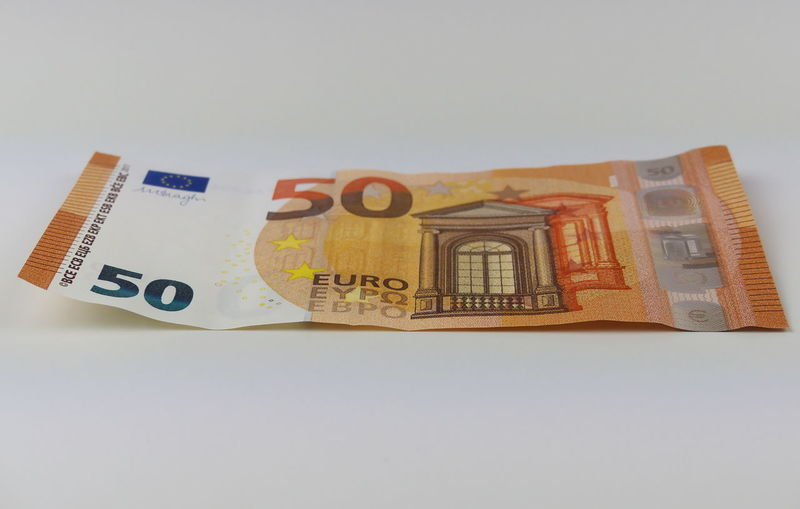 Close-up Currency Euros Finance Geldschein  Indoors  No People Paper Currency Savings Studio Shot Wealth White Background