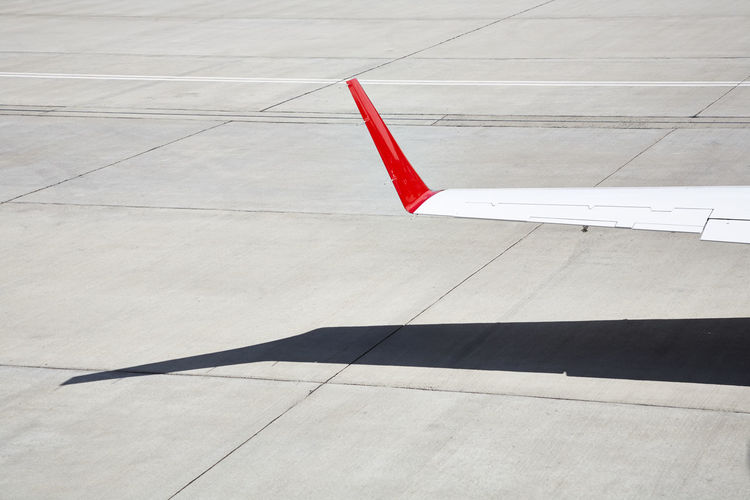 Closeup of the wing of a private jet. Aviation Day Detail Flight Fly Industry Jet Learjet Luxury No People Outdoors Private Jet Red Shadow Travel White Wing Tip