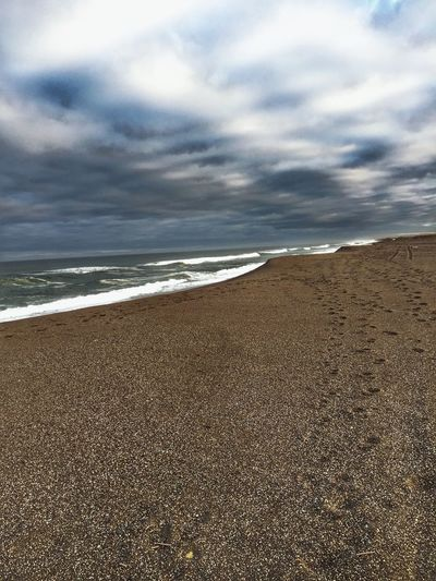 Beach Sea Sand Nature Water Sky Scenics Cloud - Sky Beauty In Nature Shore Tranquil Scene Horizon Over Water Outdoors (null)Tranquility Background Textured  Dramatic Sky Morning Light View Natural Condition Landscape Perspective Scenic Views