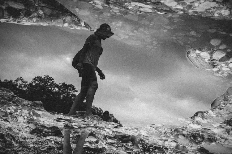 High angle view of woman reflecting in puddle