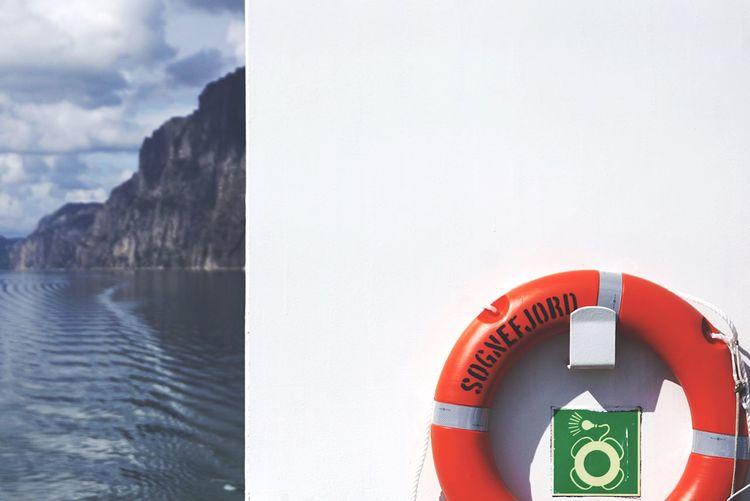 Orange life belt on ferry at sea