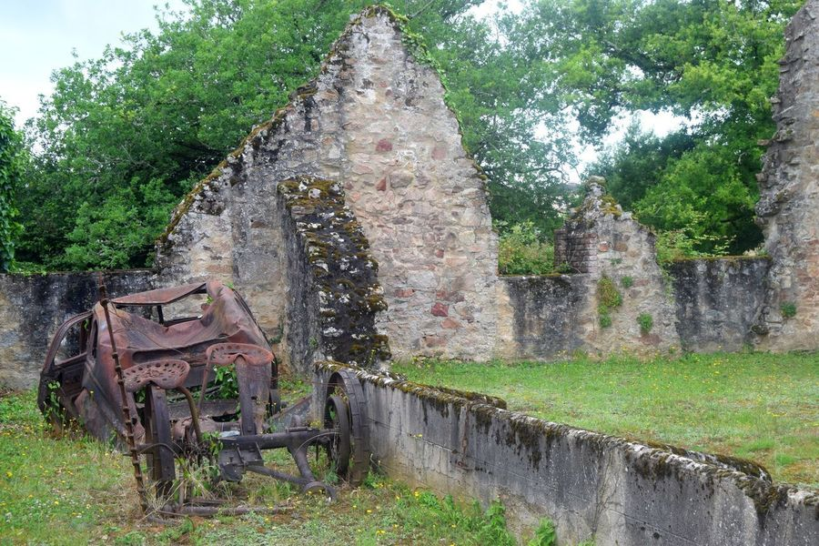 Photooftheday Picoftheday Oradour Sur Glane No People Outdoors Photography History Stone Material Day Old Town WWII Old Ruin Destruction Exploring The Week Of Eyeem France Village Newtalent Architecture Streetphotography Sky Green Color Car