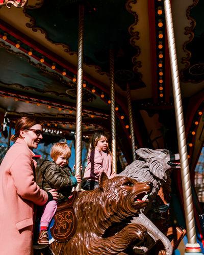 Tivoli Gardens, Copenhagen Kids Children Playing Carousel Amusement Park Ride Arts Culture And Entertainment Amusement Park Fun Hanging Happiness Merry-go-round Fairground Ride Carousel Horses Traveling Carnival Carnival
