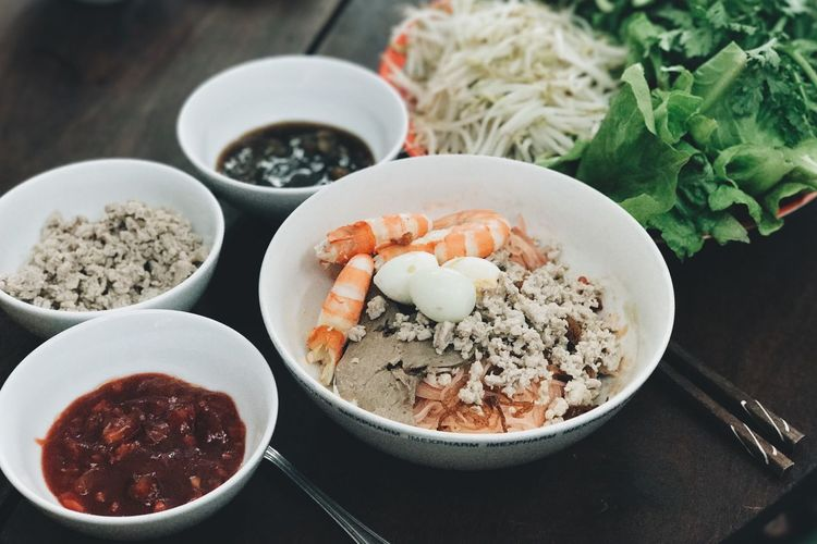 High angle view of hu tieu noodle soup ingredients
