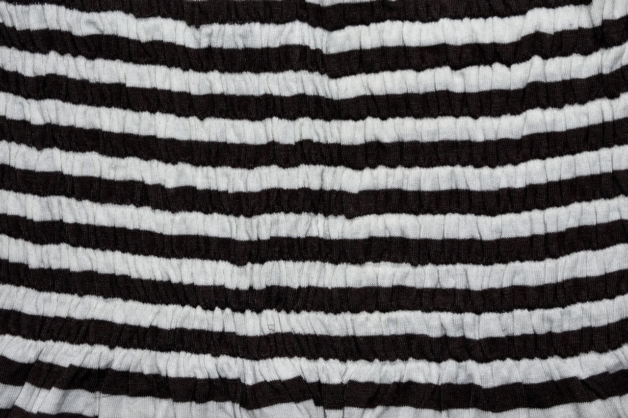 backgrounds, full frame, striped, textile, pattern, white color, close-up, no people, wool, textured, black color, indoors, cotton, extreme close-up, man made object, man made, studio shot, red, single object, woven, dark, textured effect, clean