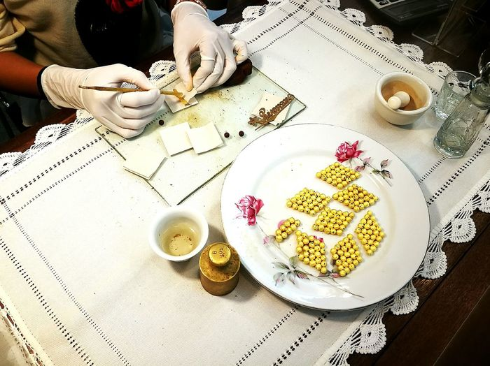 Traditional way to make medicine. Gold cover tablet Medicine Old Style tablet Traditional Medical Traditional Medicine gold sheet
