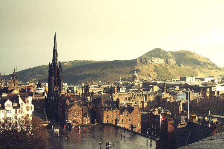 Edinburgh castle amidst buildings against clear sky