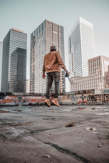 Fly high Houston Bando Fashion Rooftops Rooftop Reality Realism City Built Structure Skyscraper Building Exterior Architecture One Person Rear View Day Full Length Men City Life Outdoors Casual Clothing
