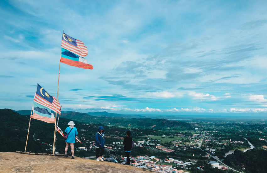""""""" Proud to be Malaysian"""" Adult Adults Only Beauty In Nature Cloud - Sky Cultures Day Eeyem Photography Flag Flags Full Length Independence Day Lightroom Malaysia Men National Icon Nature Nikonphotography Outdoors Patriotism People People Photography Real People Sky Togetherness"""