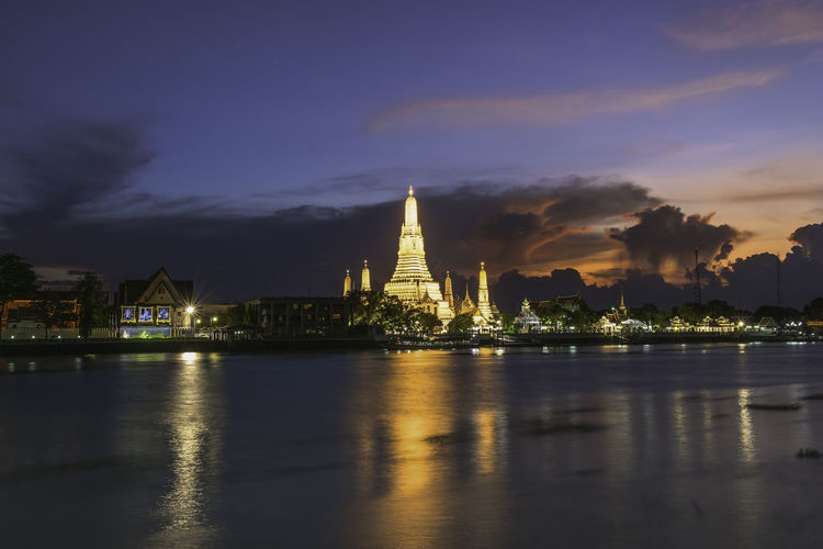 Wat Arun or Wat Arun is a temple on the west bank of the Chao Phraya River, Bangkok, Thailand. Architecture Belief Building Building Exterior Built Structure Cloud - Sky Illuminated Nature No People Outdoors Place Of Worship Reflection Religion River Sky Spire  Spirituality Travel Destinations Water Waterfront