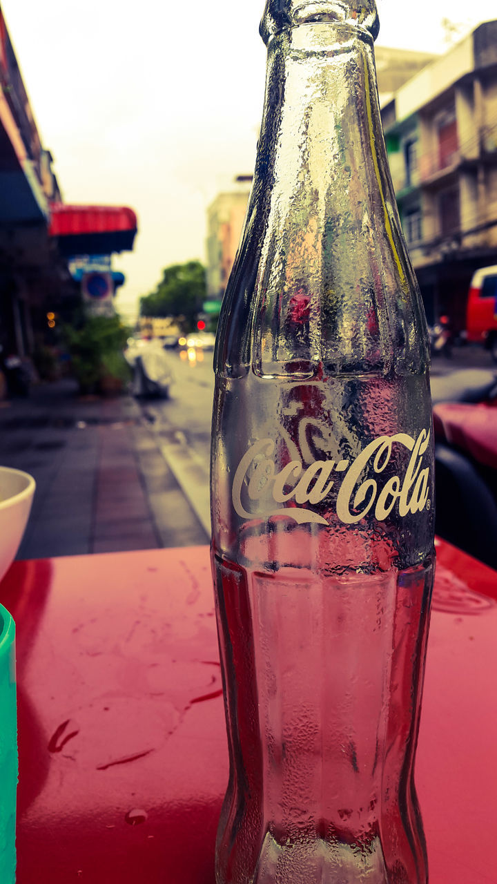 bottle, drink, close-up, drinking glass, alcohol, focus on foreground, food and drink, table, refreshment, red, beer, no people, outdoors, day, freshness, sky