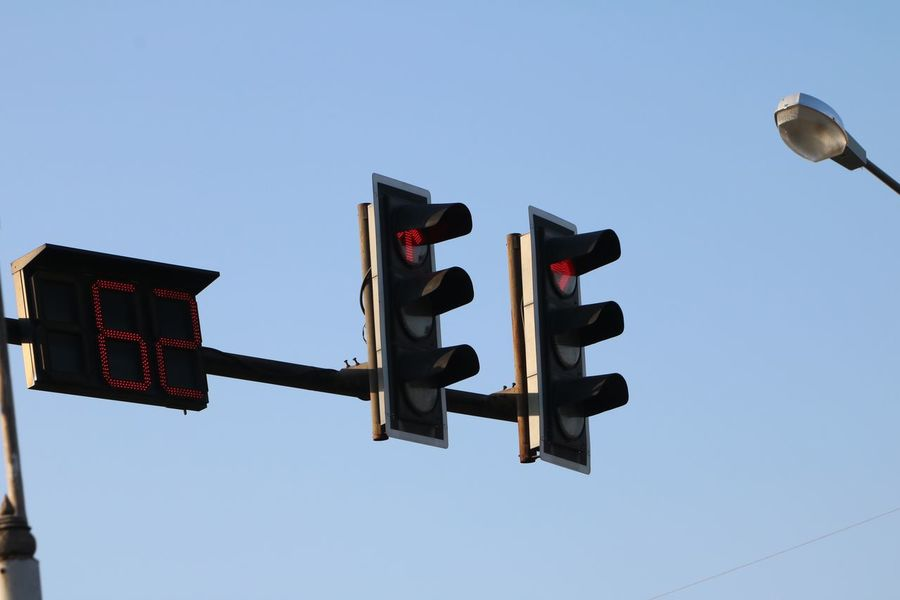 Traffic Lights Traffic Signal Low Angle View Clear Sky Guidance Outdoors Road Signal No People Red Light Day Stoplight Road Sign Sky