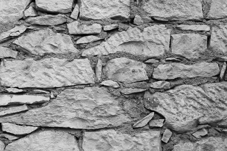 EyeEm Best Shots Eye4photography  EyeEm EyeEm Best Pics Close-up Bnw Blackandwhite Black And White Black & White Blackandwhite Photography Monochrome Backgrounds Abstract Full Frame Textured  Stone Material Architecture Pattern Rough Stone Wall Outdoors Wall - Building Feature Wall Built Structure Stone - Object