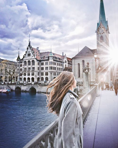 Architecture Built Structure Building Exterior Real People Sky Rear View Leisure Activity Lifestyles Outdoors Casual Clothing Travel Destinations Tourism Day Place Of Worship One Person Religion Women History Cloud - Sky Spirituality Limmatquai Limmat Zürich Zürich My City Zurich, Switzerland