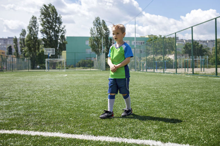 Full length of siblings on soccer field