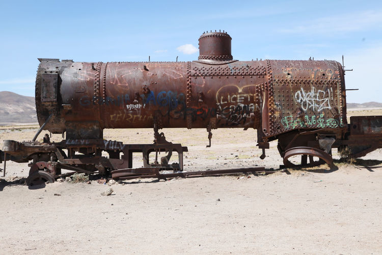 Wreck of steam engine at train cemetery