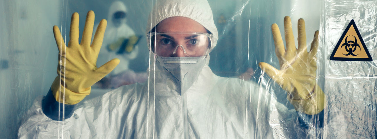 Portrait of doctor standing wearing protective suit