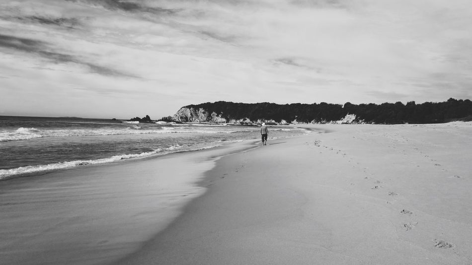 Beach Man Isolated Alone Beach Sea Sand Sky Nature Real People Scenics Wave Water Day Beauty In Nature Vacations Leisure Activity Cloud - Sky Outdoors Horizon Over Water Lifestyles One Person People Walk Black And White