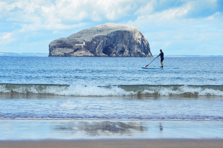 Adventure Bass Rock Beach Beach Life Beach Photography Beachphotography Cloud - Sky Gulls Horizon Over Water Leisure Activity Nature One Person Paddle Boarding Paddleboarding Real People Reflection Scenics Scotland Scotland 💕 Sea Sky Standing Water Waterfront Wave