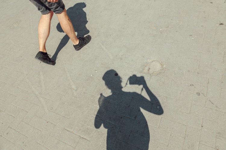 Hard Shadows Shadowplay Walking Around Adult Adults Only Day High Angle View Human Body Part Human Leg Leisure Activity Lifestyles Low Section Men Outdoors People Real People Self Portrait Shadow Summer Sunlight Togetherness Two People