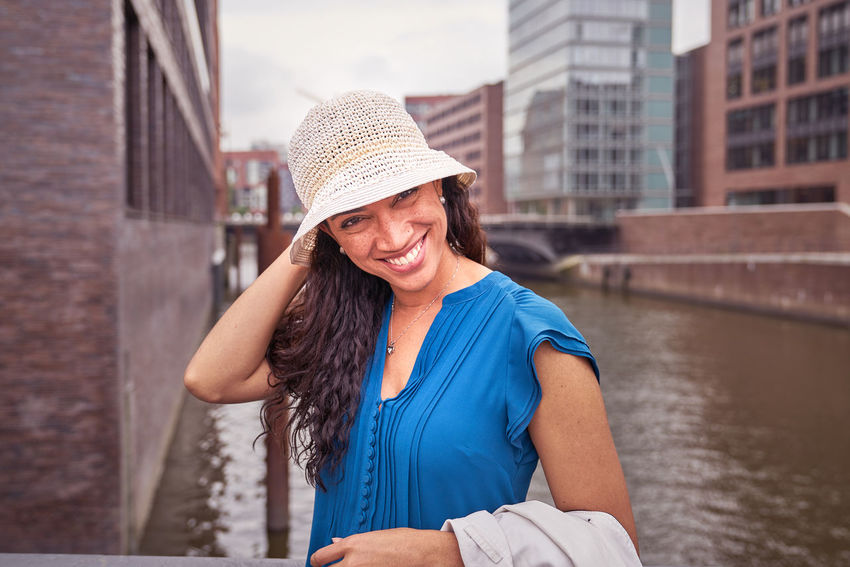 On a great summer day, I shoot these Pictures from the Model Fernanda. She come from Venezuela and her smiling is amazing Adult City Life Lifestyle Looking At Camera Portrait Of A Woman Standing Summer Dress Beautiful Woman Blue Skirt Brown Hair Casual Clothing Day Face Focus On Foreground Leisure Activity One Person Portrait Reale People Smiling Straw Hat Town Canal Urban Vanezuela Water Canal Women EyeEmNewHere