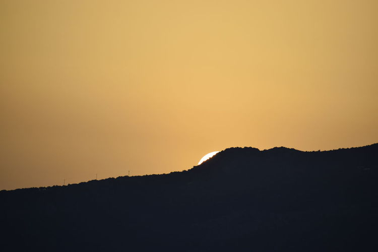 Summer sunset in southern Greece Sunset_collection Astronomy Beauty In Nature Clear Sky Copy Space Dark Environment Greece Idyllic Landscape Mountain Nature No People Noedit Non-urban Scene Orange Color Outdoors Remote Scenics - Nature Silhouette Sky Sunset Tranquil Scene Tranquility Wallpaper