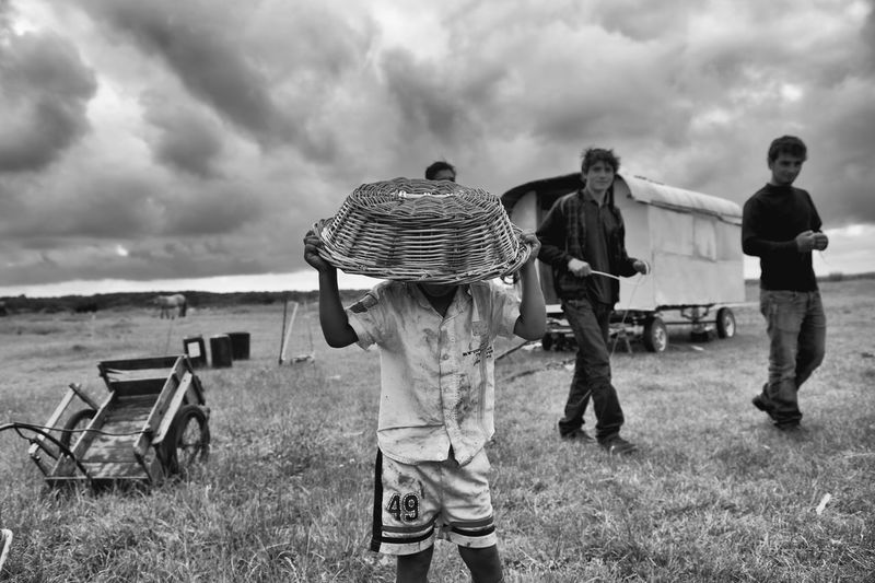 The Photojournalist - 2017 EyeEm Awards La Pièta Des Roms Field Cloud - Sky Grass Sky Day Real People Standing Outdoors Casual Clothing Men Nature Leisure Activity Togetherness Full Length Young Adult Adult People Nikon D4S 35mm