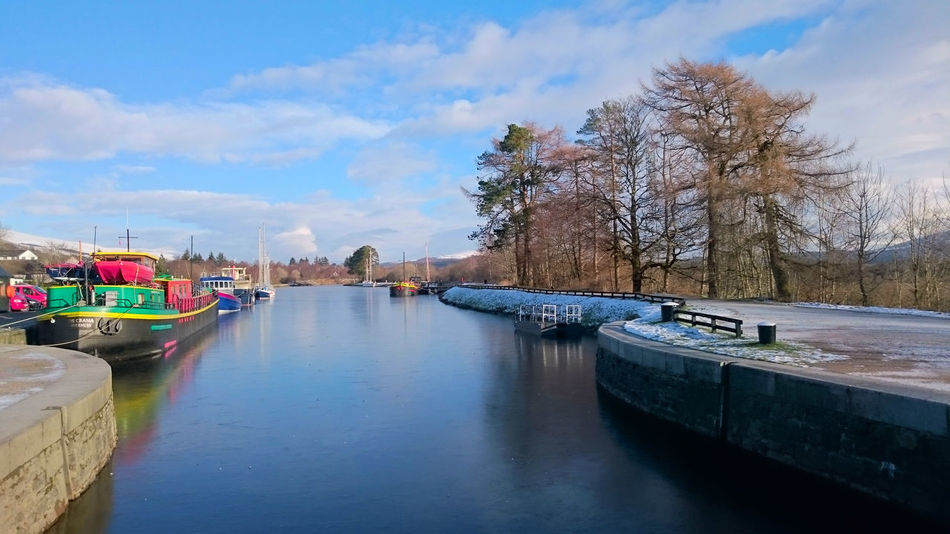 Caledonian Canal Architecture Bare Tree Beauty In Nature Building Exterior Built Structure Canal Cloud - Sky Day Moored Nature Nautical Vessel No People Outdoors River Scenics Sky Transportation Tree Water