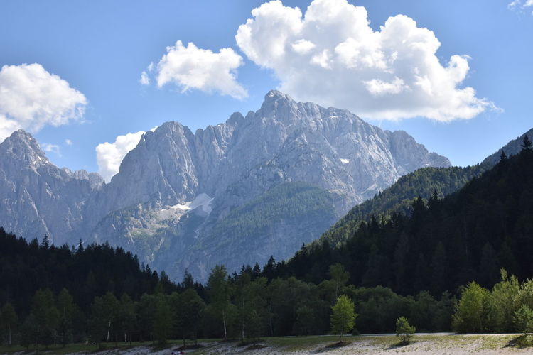Lakes & Mountains in Lake Jasna, Slovenia Mojstrana Slovenia Beauty In Nature Cloud - Sky Environment Forest Growth Height High Lake Jasna Land Landscape Mountain Mountain Peak Mountain Range Nature No People Plant Range Scenery Scenics - Nature Sky Tree Wallpaper Wilderness