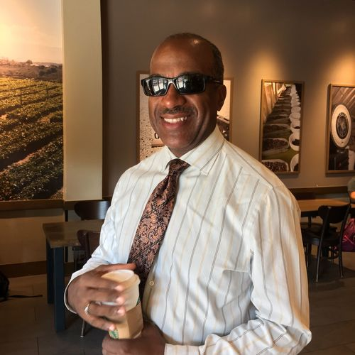 EyeEm Selects Chancellor University Looking At Camera One Person Smiling California Sunglasses Portrait Front View Indoors  Glasses Mature Adult Coffee Lifestyles