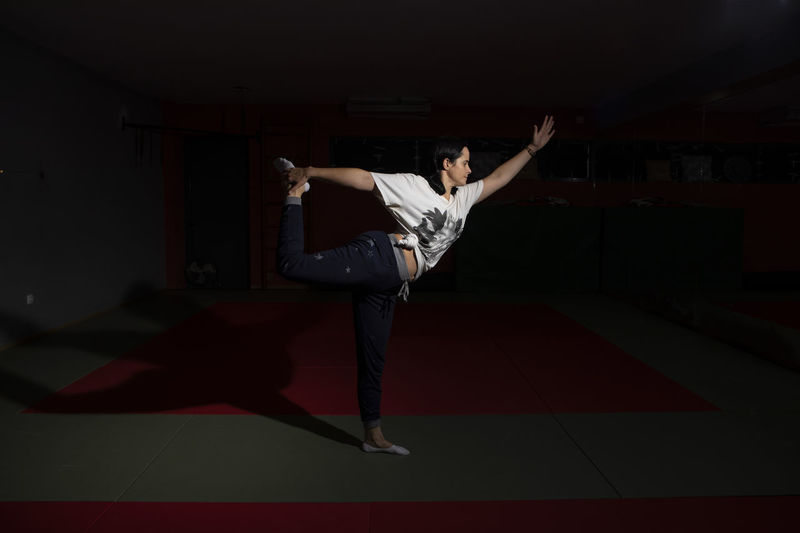 Portugal; Aula de Yoga Yogagirl Yoga Poses Full Length One Person Human Arm Limb Arms Raised Young Adult Indoors  Real People Performance Red Jumping Human Limb Human Body Part Vitality Body Part Motion Casual Clothing Mid-air Men Stage Excitement