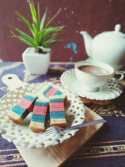 sarawak layered cake Drink Tea - Hot Drink Multi Colored Table Tablecloth Sweet Food Close-up Food And Drink Slice Of Cake Afternoon Tea Black Coffee Saucer