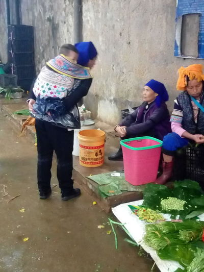 market scene at Jianshui, Yunnan Province, PR of China Baby Food And Drink Fruits And Vegetables Jianshui Market Scene Jianshui Market Jianshui, Yuannan Women At Work Womenaroundtheworld Adventures In The City Baby Carriage Females Food Photogrphy Fruit Market Scene Women Women Talking