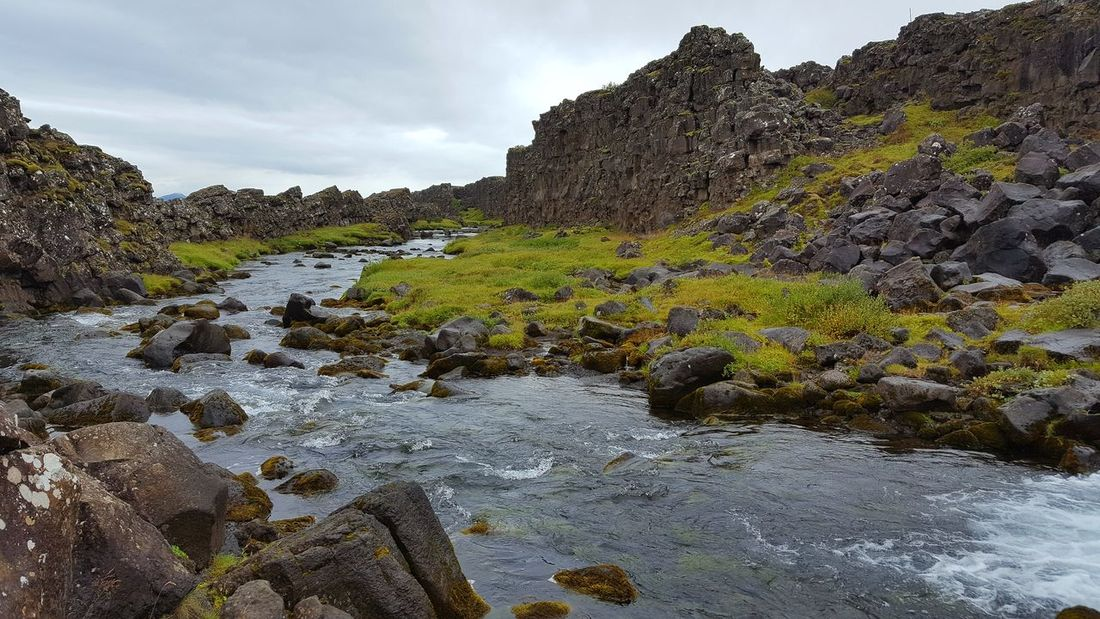 Beauty In Nature Flowing Flowing Water Game Of Thrones Idyllic Nature Non-urban Scene Outdoors Physical Geography Pingvellir River Rock - Object Rock Formation Scenics Sky Stone Stone - Object Stream Tourism Tranquil Scene Tranquility Travel Destinations Tree Vacations Water