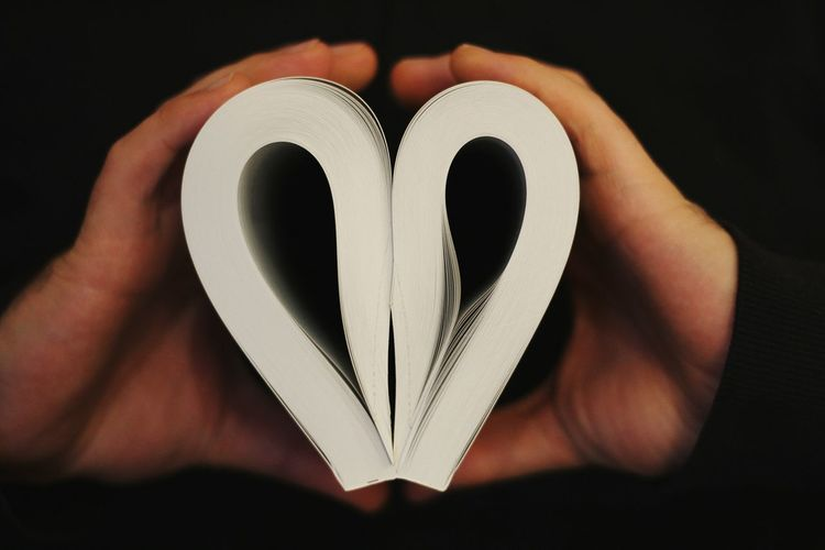 Book Reading Reading A Book Human Hand Black Background Close-up Heart Shape Candy Heart I Love You