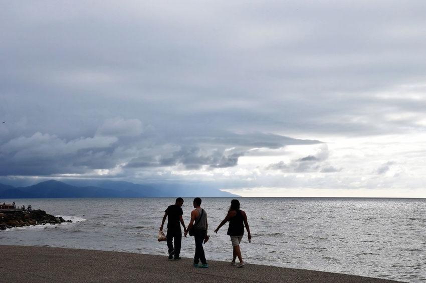 A Walk on the Beach Beach Combing Beach Life Cloudy Day Strolling Beach Stroll Beach Walking Cloudy Day At The Beach People People Walking  People Walking On Beach Strolling On The Beach Walk By The Ocean